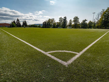 Football or Soccer green grass field, detail of the corner