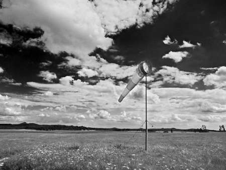 Summer hot day on sport airport with moving windsock, 스톡 콘텐츠
