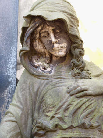 The broken face of crying woman statue on tombstone. 24th of October 2020. Hronov, Czechia. Heloween walk in old town graveyard
