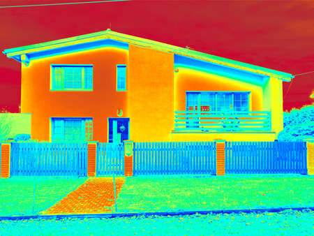 Low emission facade and heat losses measurement result. Building after complete insulation. Infrared thermovision display. Photo building color scale, heat dispersion.