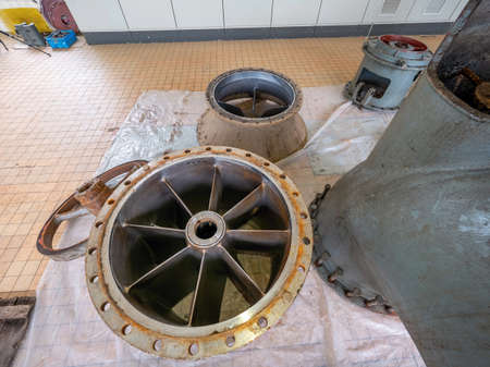 Flange with riser blades in axial hydrodynamic pump turbine. Overhaul of pumping wastewater station.