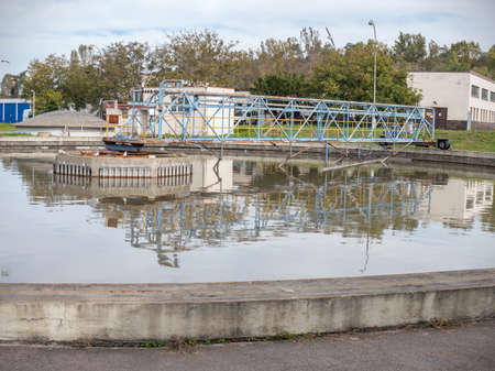 Collector bridge of a primary sedimentation tank in a sewage water treatment plant. Mechanical cleaning raks. Stock fotó