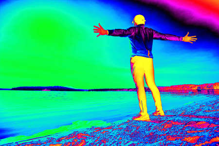 Middle age happy guy during morning exercising on the sandy beach over sea. Gamma radiation spectrum in simulator. Stock fotó