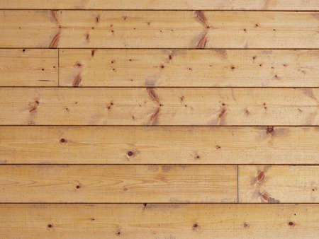 View of sharped wooden planks in the wooden cabin wall. Glazed spruce planks joined with tongue and groove Zdjęcie Seryjne