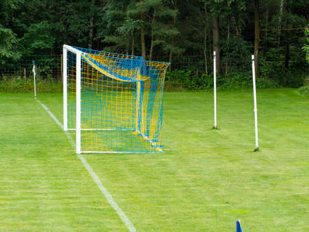 Training soccer field with green turf. Football field with goals and markings or side lines