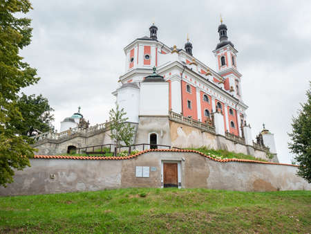 Baroque church in Luze Kosumberk, Czech Republic. Cloudy rainy sky.