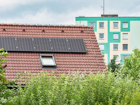 Renewable energy from Sun. Modern house with solar panels on the roof Imagens
