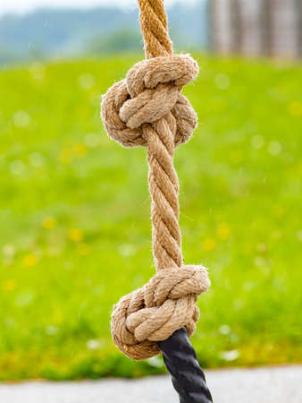 White rope and double knot at outdoor playground.