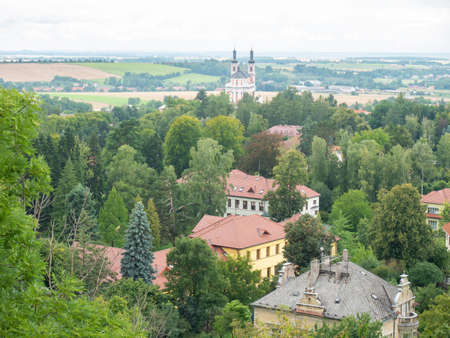Luze village with baroque church sticking up from park. Travel in central Czechia, Europe.