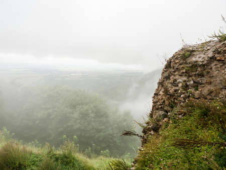 Morning cloudy view from top of ancient settlement castle ruin