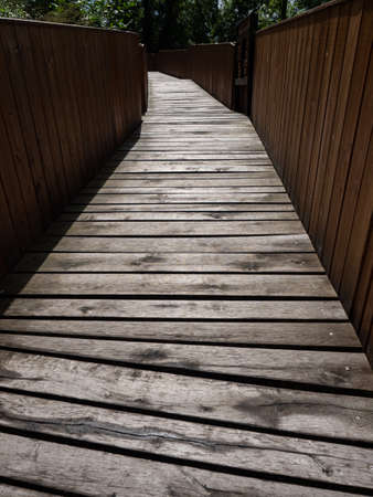 Wooden bridge of ancient fortres, wooden pathway and coridor Imagens