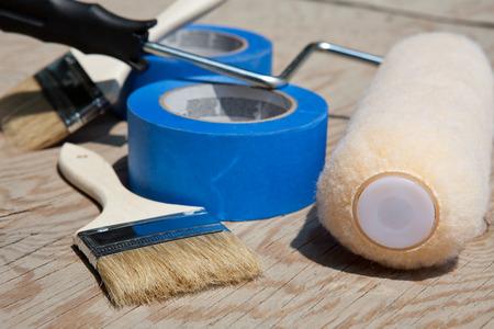 Renovation set  Brush, blue tape and ruler over plywood  photo