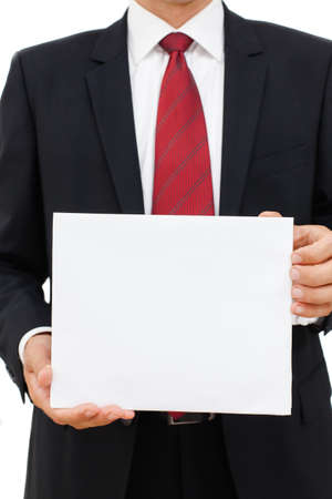 Happy business man holding a blank sheet of paper on white to write your text  photo