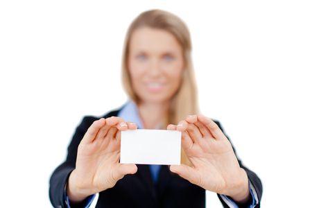 Smiling business woman holding a blank sheet of paper on white to write your text  photo