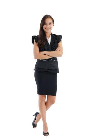 mujer cuerpo completo: Empresaria profesional conf�a en pie en traje de falda aislado en fondo blanco Foto de archivo