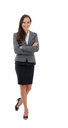 Professional businesswoman standing confident in skirt suit isolated on white background  photo