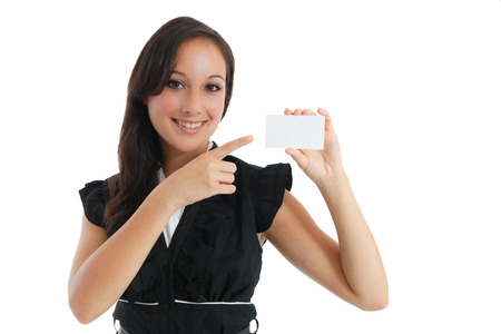 Smiling business woman holding a blank sheet of paper on white to write your text