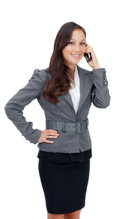 Close-up portrait of a successful business woman talking on cell phone, isolated on the white background  photo