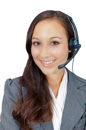 Closeup portrait of a beautiful young woman with a headset , call centre employee, against white background  Copy space