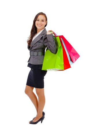 Portrait of stunning young woman carrying shopping bags against white background  Stock Photo - 26538986