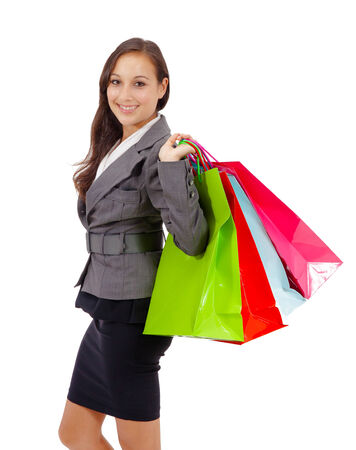 Portrait of stunning young woman carrying shopping bags against white background Stock Photo - 26538988