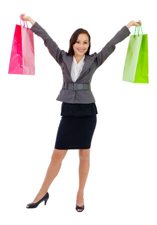 Portrait of stunning young woman carrying shopping bags against white background  Stock Photo - 26538991