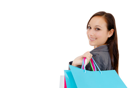 Portrait of stunning young woman carrying shopping bags against white background Stock Photo - 26538990