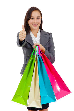 Portrait of stunning young woman carrying shopping bags against white background Stock Photo - 26538994