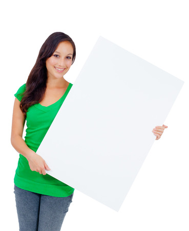 Woman holding signboard billboard smiling fresh  Beautiful playful casual Caucasian woman showing blank sign  Isolated on white background  photo