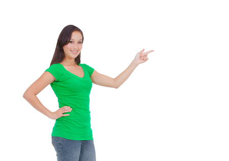 Showing, giving or presenting  Portrait of a beautiful young woman, holding out her hand as displaying something  Ready for you to add text  An attractive young woman in a stylish shirt isolated on a white background  photo