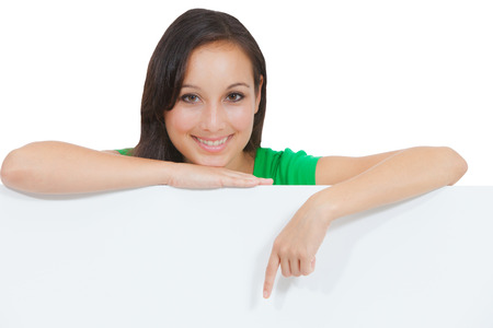 signboard: Woman holding signboard billboard smiling fresh  Beautiful playful casual Caucasian woman showing blank sign  Isolated on white background