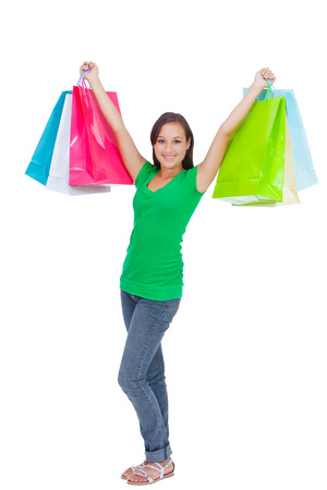 Portrait of stunning young woman carrying shopping bags against white background  photo