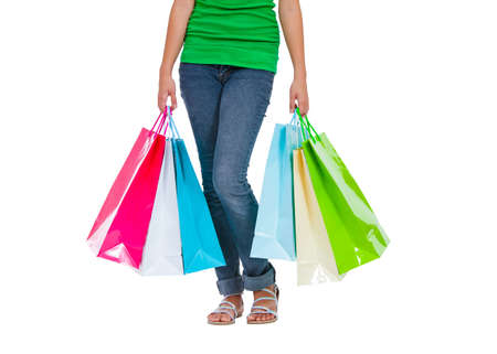 Portrait of stunning young woman carrying shopping bags against white background Stock Photo - 26539117