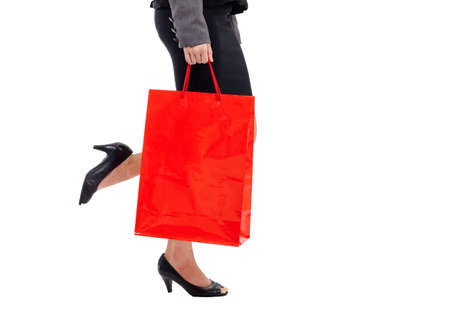 Beautiful woman leg with a lot of shopping bags photo