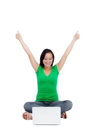 Portrait of successful woman with clenched fist and holding arms up  An image of success, victory, a winner  Isolated on white background  Copy space  photo