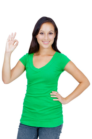 Portrait of a happy female showing an OK sign isolated over white  photo