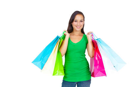 Portrait of stunning young woman carrying shopping bags against white background  Stock Photo - 26567681