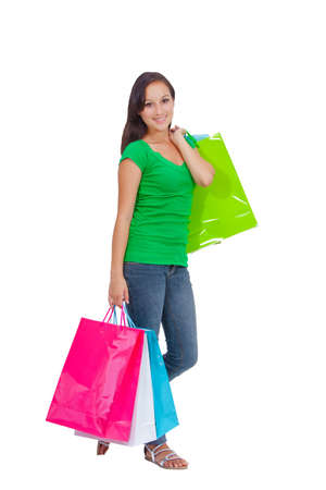 Portrait of stunning young woman carrying shopping bags against white background  Stock Photo - 26567684