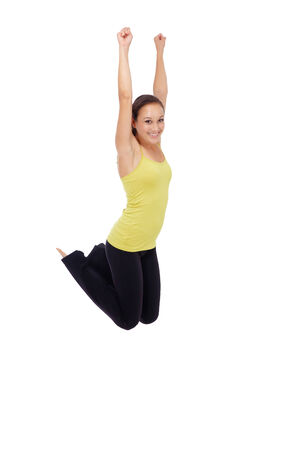 Fitness woman jumping excited isolated on white background  Full body image of beautiful Caucasian female model in jump flexing and showing muscles  photo
