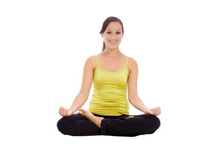 Beautiful woman doing yoga isolated on white background photo