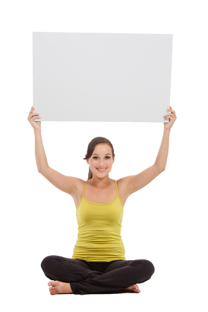 sport fitness woman hold blank board advertisement with empty copy space, young healthy smile girl athletic muscle body, perfect figure isolated over white background photo