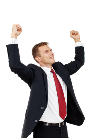 Portrait of Successful businessman with clenched fist and holding arms up  An image of success, victory, a winner  Isolated on white background