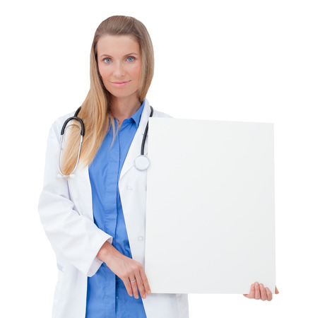 Portrait of a  smiling young Doctor holding a blank sheet of paper on white to write your text  Isolated on a white background  Copy space  photo