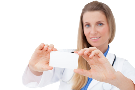 Portrait of a happy young Doctor holding a blank sheet of paper on white to write your text  Isolated on white background  photo