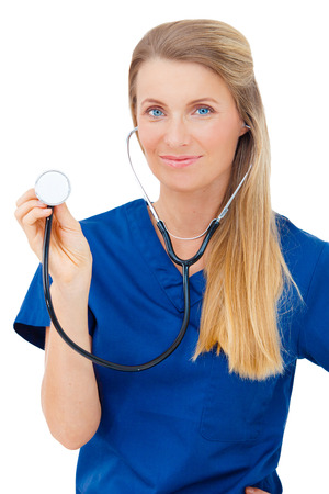 Portrait of a happy young Medical doctor showing stethoscope close up isolated on white background  photo