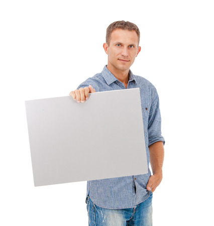 white sheet: A handsome young man holding a placard over white  Stock Photo