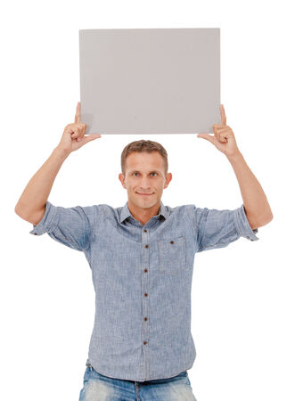 one sheet: A handsome young man holding a placard over white  Stock Photo