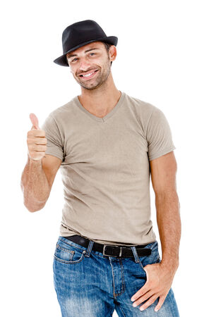 thumbsup: Smiling young man giving you the thumbs up against white