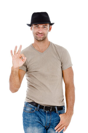 Young smart man indicating OK sign, isolated over white background  photo