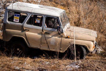 Jeep UAZ overcomes obstacles in the forest